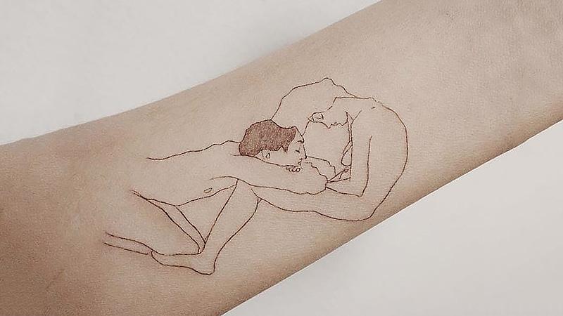 Мужчина и женщина. Татуировщик Doy